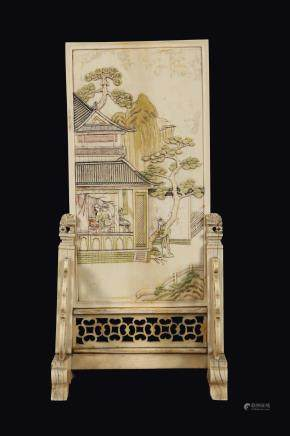 "A carved ivory ""landscape and peach branch"" plaque, China, Qing Dynasty, 19th century"