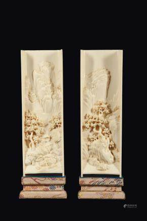 A pair of carved ivory plaques with mountain landscape in relief, China, Qing Dynasty, 19th century
