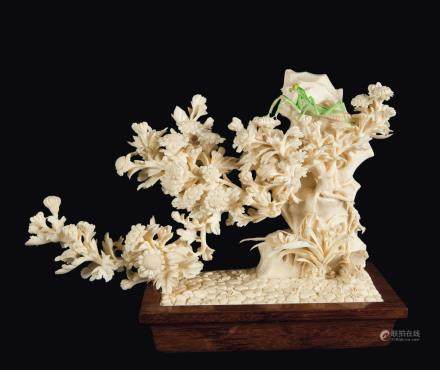 "A carved ivory ""mantis and flowers"" group, China, early 20th century"