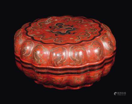 A large carved red lacquer box and cover with dragons and bats, China, Qing Dynasty, 19th century