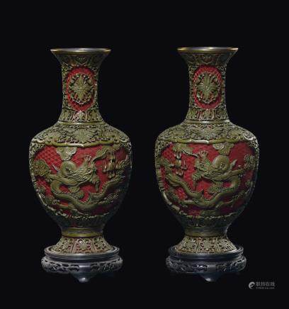 A pair of lacquer vases with dragons in relief, China, Qing Dynasty, 19th/20th century