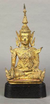 Thai bronze seated Buddha, ornately adorned, fronted by diamond form plaques to the chest, in