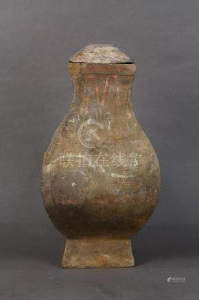 Chinese Han polychrome lidded ceramic jar, square sectioned, bracketed by zoomorphic handles with