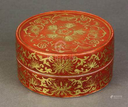 Chinese gilt red porcelain circular box, the exterior with stylized gilt lotus on a coral red