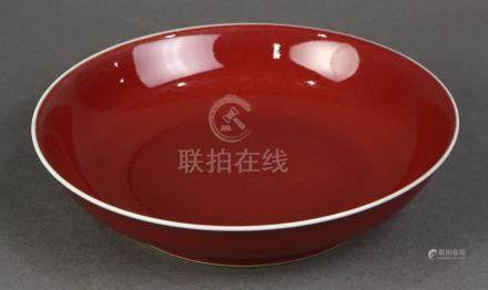 Chinese ox blood glazed porcelain plate, the recessed base with an apocryphal underglaze blue