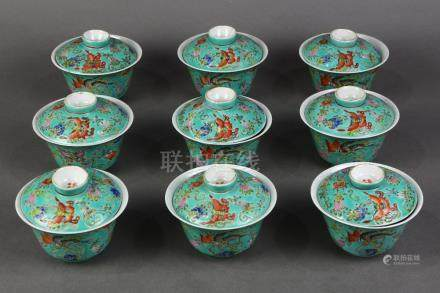 (lot of 9) Chinese enameled porcelain lidded cups, depicting butterflies and fruiting vines on a