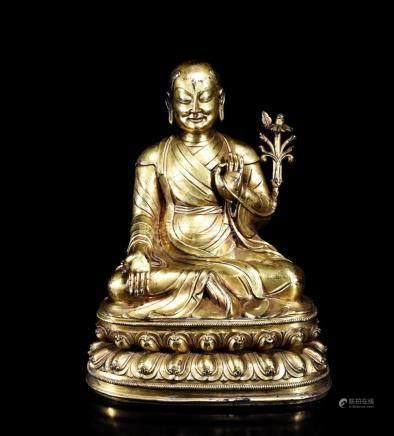 A GILT BRONZE BUDDHA GURU