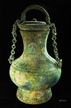 LARGE ARCHAIC BRONZE LIFTING HANDLE POT, HAN DYNASTY, CIRCA