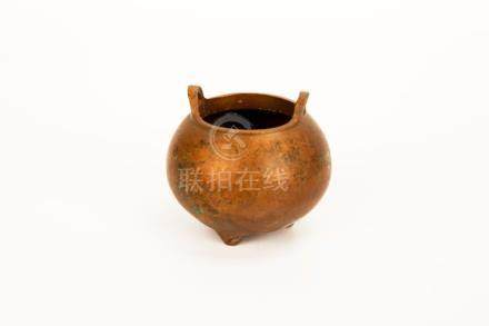 A LOTUS SHAPED DOUBLE EAR BRONZE CENSER. A CHARACTER XUAN MA
