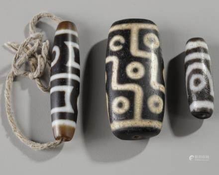 Three Tibetan Dzi beads