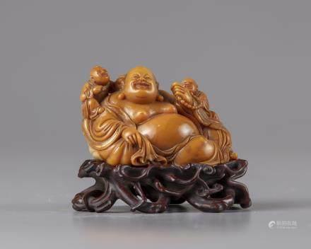 A soapstone figure of Budai
