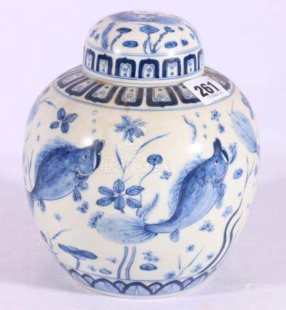 20th Century blue and white ginger jar and cover decorated with fish, six character mark to base,
