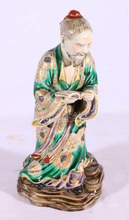 Chinese early 20th Century famille verte figure of a man reading a book,