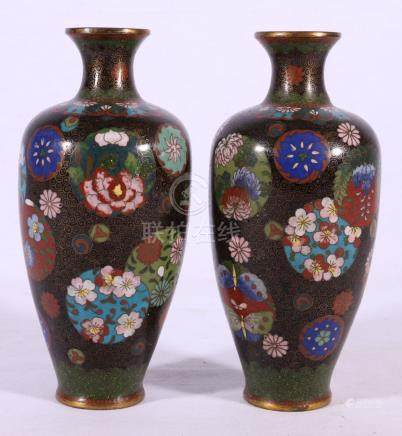 Pair of Japanese cloisonne high shouldered vases with floral roundels on a dark ground, 18.5cm.