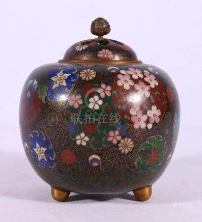 Japanese cloisonne censer and pierced cover, the black ground decorated with floral roundels,