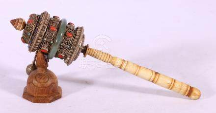 Tibetan prayer wheel, with turned bone handle and jade central band, prayer scroll to the interior,