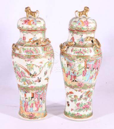 Pair of 19th Century Chinese Canton famille rose vases and covers,