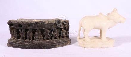 Indian carved white stone model of a cow and a part frieze carved with figures on either side of a