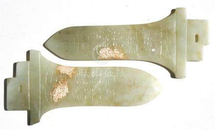 A pair of Chinese jade archaic style dagger blades, 15cms (6ins) long (2).