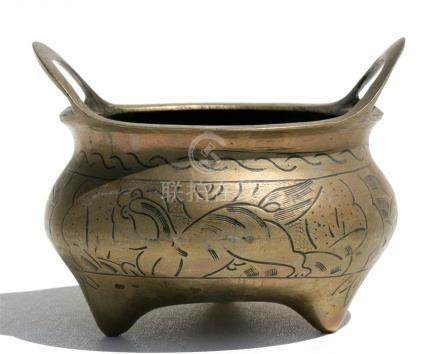 A Chinese two-handled censer decorated with fo dogs, 12cms (4.75ins) diameter.