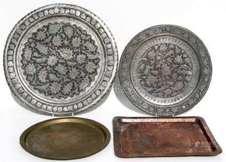A group of four Islamic / Egyptian trays or chargers, the largest 50cms (19.75ins) diameter.