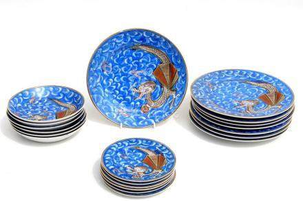 A Japanese dinner service decorated with dragons on a blue ground, comprising 8 dinner plates, 6