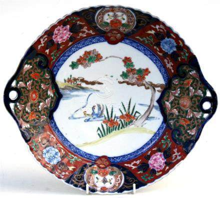 A Japanese Imari plate decorated with birds within a foliate border, Phillips lot number to verso,