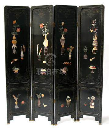 A 20th century Chinese black lacquer four-fold screen, one side inlaid with hardstone and