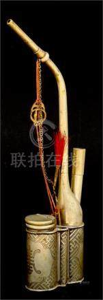 A Chinese opium pipe. 31cm (12.25ins) high