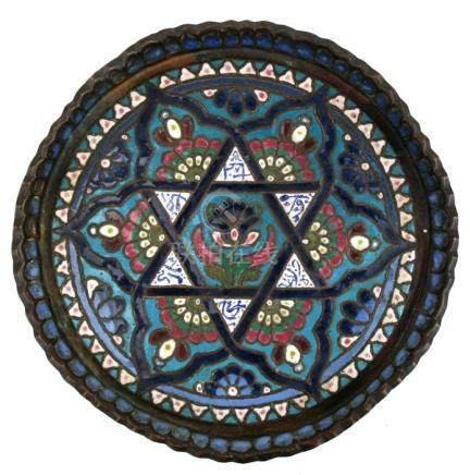 A Syrian enamelled copper tray decorated with a central flower within a star and calligraphy. 31cm