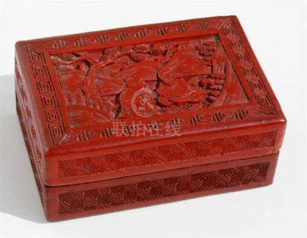 A 19th century Chinese cinnabar lacquer box decorated with seated figures in a garden, 9.7cms (3.
