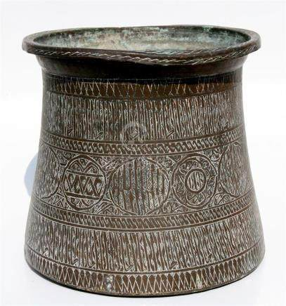 A large Eastern brass palm pot with Islamic script roundels and other engraved decoration, 31cms (