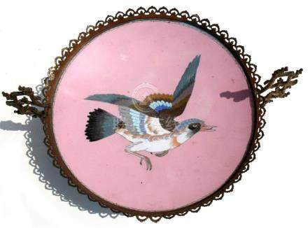 A late 19th century Japanese cloisonne plate decorated with a central bird on a pink ground, later