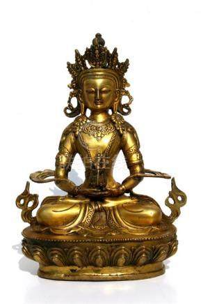 A large gilt bronze figure of a seated Buddha, 28.5cms (11.2ins) high.