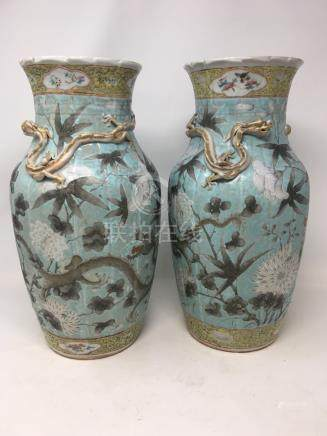 A pair of mid 19th Century famille rose yellow and turquoise ground vases.