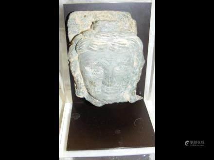 A Tibetan green schist head of a Deity - 2nd/3rd c