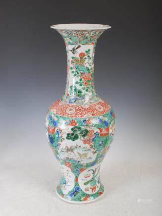 A Chinese porcelain famille verte baluster shaped vase, Qing Dynasty, decorated with panels of deer,