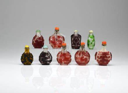 GROUP OF NINE CHINESE OVERLAY GLASS SNUFF BOTTLES