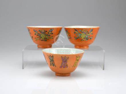 THREE CORAL GROUND FAMILLE ROSE PORCELAIN BOWLS