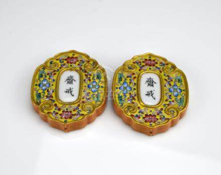 TWO FAMILLE ROSE PORCELAIN FASTING PLAQUES