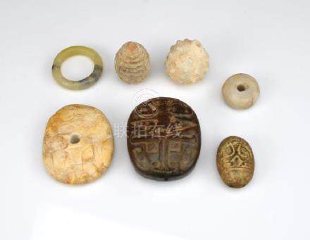 SEVEN CHINESE CARVED ARCHAISTIC JADE PIECES