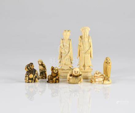 GROUP OF EIGHT CHINESE AND JAPANESE IVORY CARVINGS