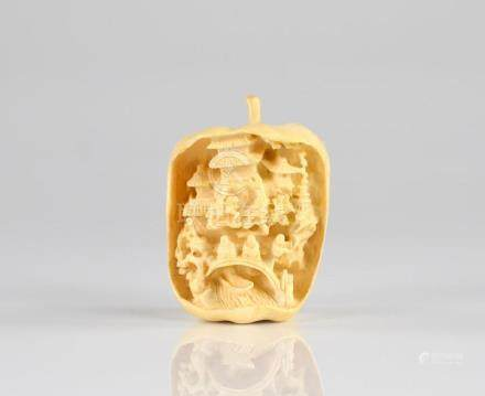 CHINESE IVORY CARVED APPLE WITH MINIATURE INTERIOR