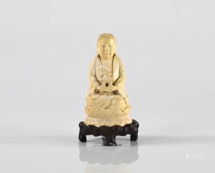 CHINESE CARVED IVORY BUDDHA FIGURE