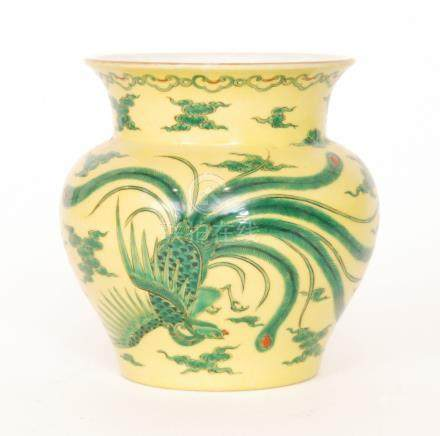 An early 20th Century Japanese vase decorated with a green dragon and a long tailed feathered bird
