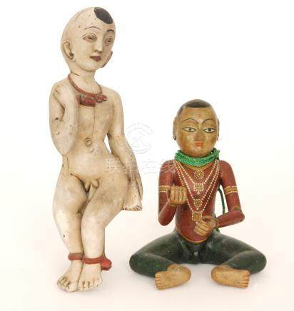 A Burmese carved wooden figure of a child with painted finish and another (2)