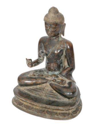 A Ming dynasty Thai bronze Buddha meditating in seated pose with right hand held in the Karana