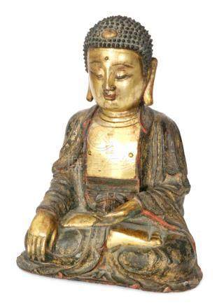 A Chinese Ming dynasty (1368-1644) gilt bronze figure of Buddha,
