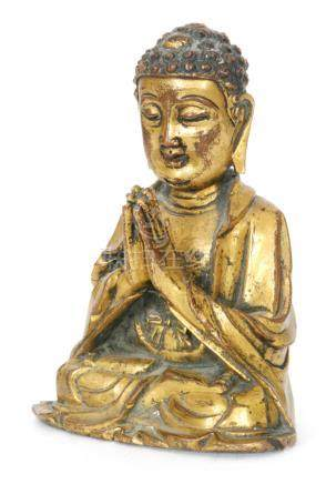 A small Chinese Ming dynasty (1368-1644) gilt bronze figure of Buddha meditating in the dhyanasana