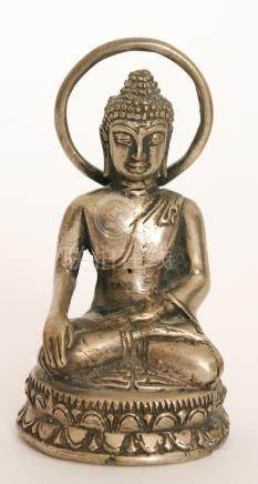 A small seated Buddha meditating in the dhyanasana pose,